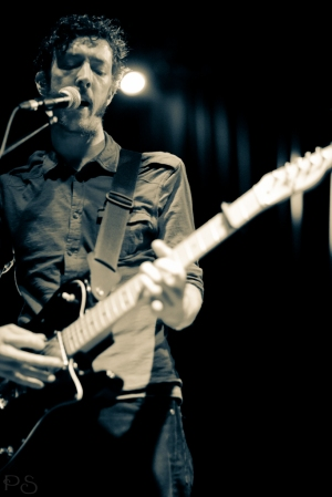 This is David Playing guitar at a gig in 2013. The photograph was taken by Petr Stary